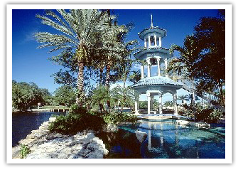 A Tarpon Bend home   with water park style pool and bell tower.